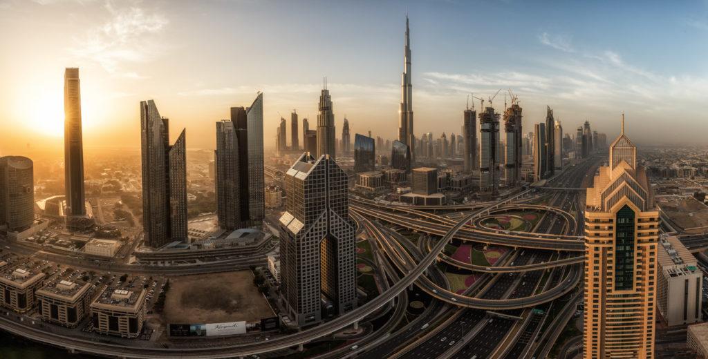 Sunrise behind the Skyline of Downtown Dubai with the famous Burj Khalifa