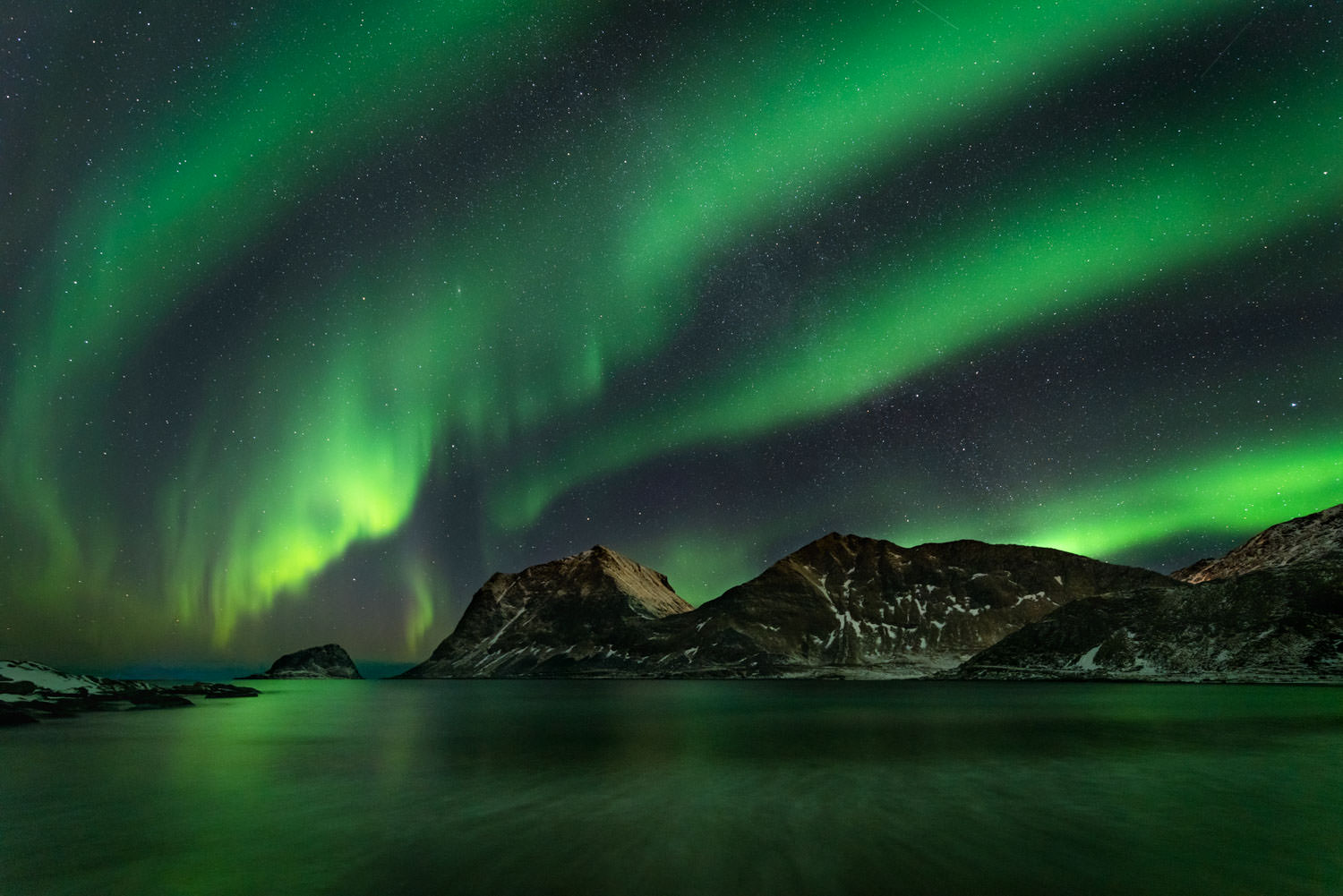 Milky Way and Northern Lights at Haukland Beach in Norway