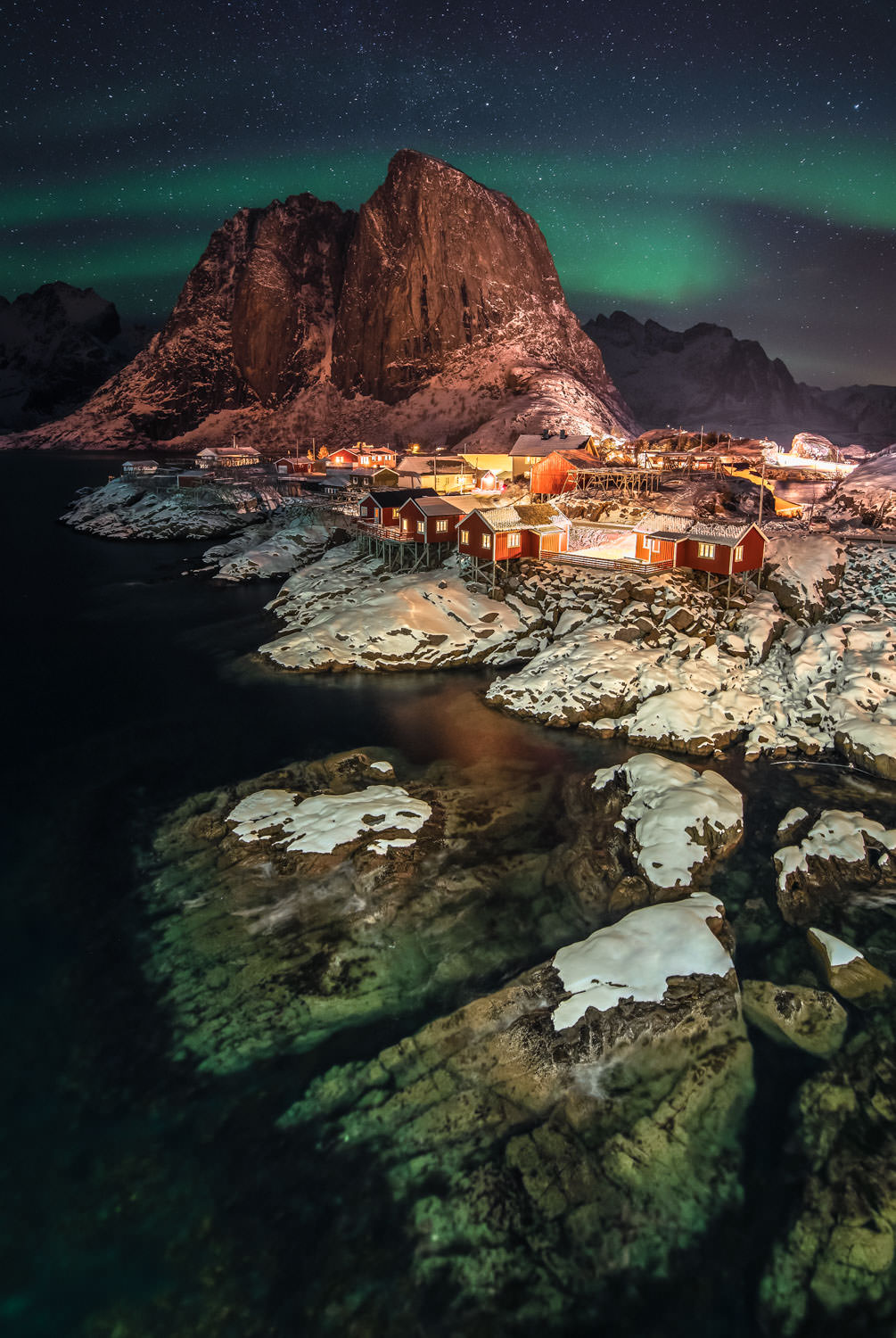 Northern Lights over the fishing village Hamnøy in Norway